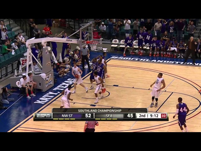 Northwestern State's Brison White goes behind the back for a lay in