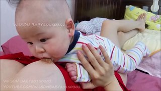 WILSON BABY BREASTFEEDS DURING TUMMY TIME POS DAY134  cho con b 2 2 2
