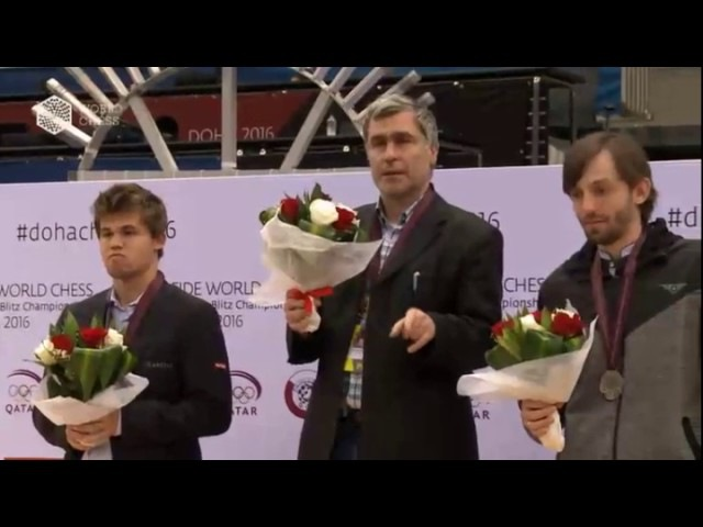 Vassily Ivanchuk playing checkers during the award ceremony 2016
