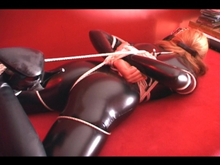 Virgin Slave Girl in Black pvc Catsuit Hogtied on Bench Fondled and Caressed by Teresa May and Mel (Inxesse)