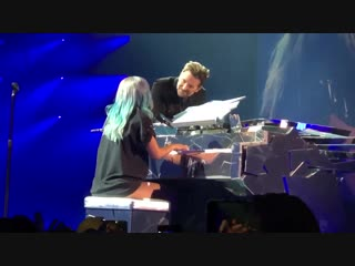 Bradley cooper attends enigma show and joins lady gaga on stage to perform shallow