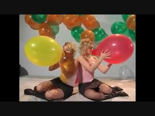 Nice Girls Couple inflate and blow up balloons
